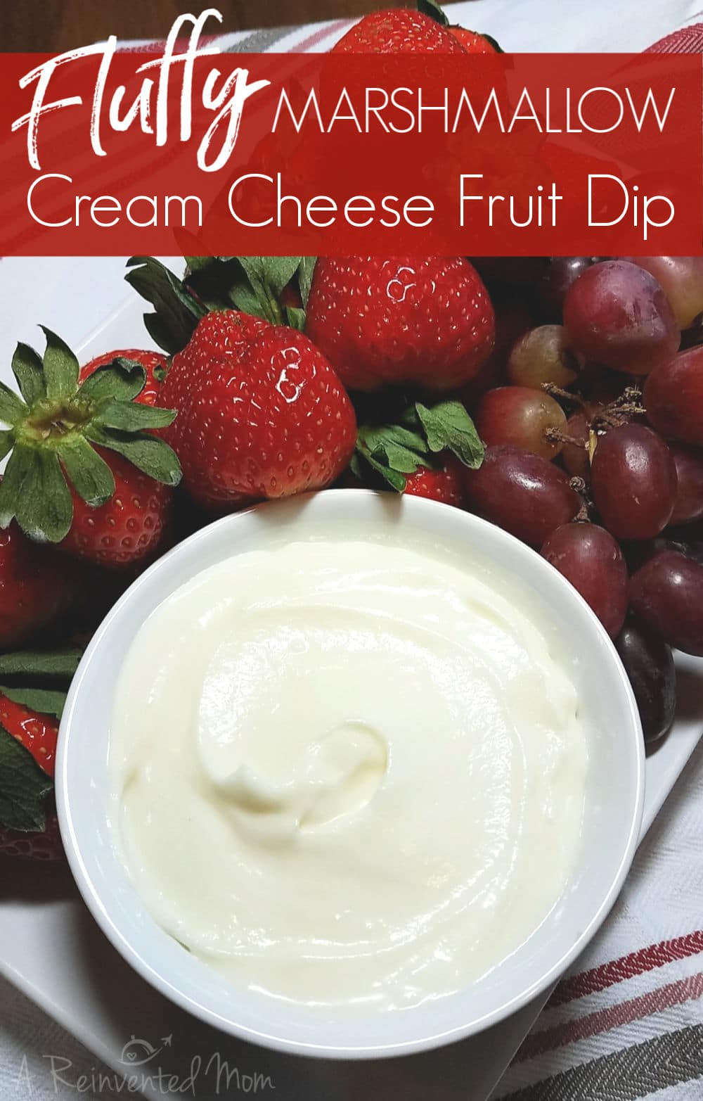 White bowl of Fluffy Marshmallow Cream Cheese Fruit Dip with strawberries & grapes. | A Reinvented Mom #marshmallowcreamcheesefruitdip #fruitdip #fluffdip