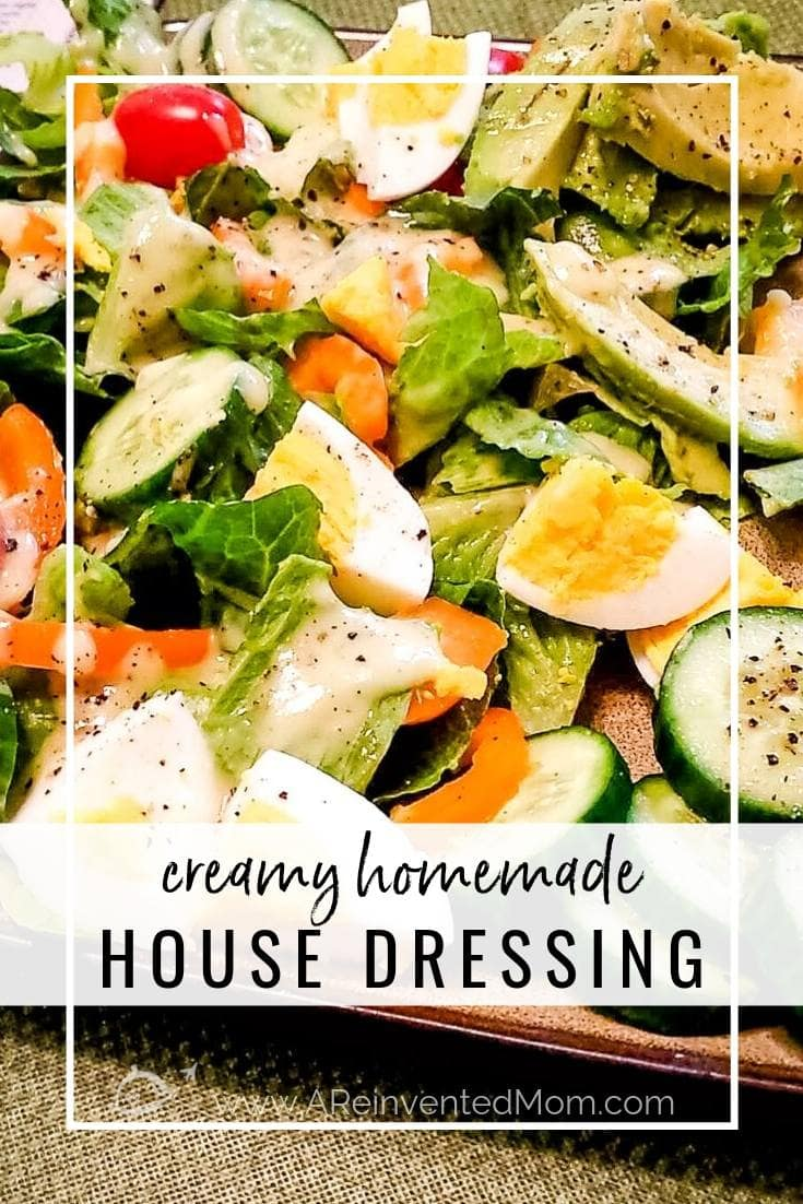 A plate filled with green salad with cucumbers, carrots, boiled egg & Creamy Homemade House Dressing | A Reinvented Mom