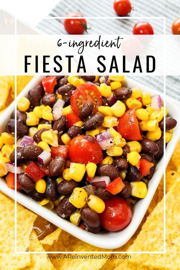 Bowl of corn, black beans, tomatoes & peppers with tortilla chips | 6-Ingredient Fiesta Salad by A Reinvented Momin a bowl