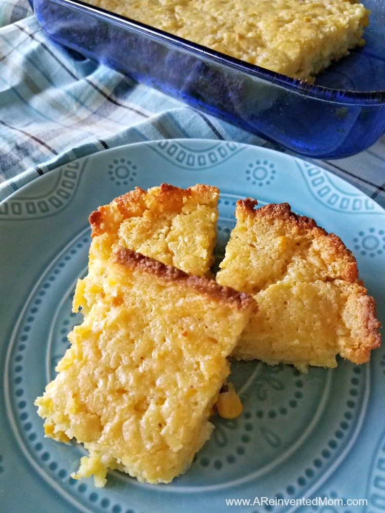 Decorative blue plate with 3 slices of Katie's Cornbread Casserole | A Reinvented Mom