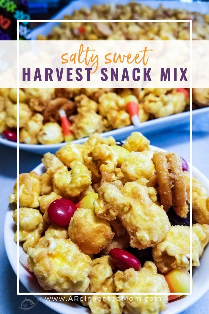Close up photo of bowl of popcorn, snack crackers, candy corn & chocolate coated candies. Salty Sweet Fall Harvest Snack Mix | A Reinvented Mom