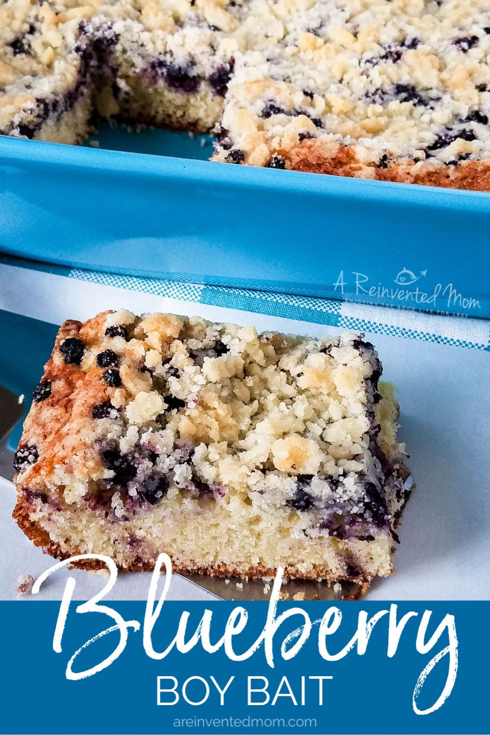 Slice of Blueberry Boy Bait on spatula with cake pan in the background.