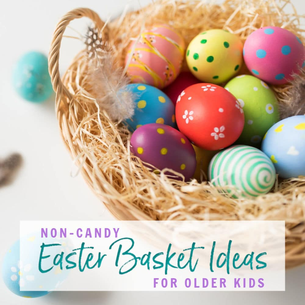 Closeup of basket with colored eggs. Non-candy Easter basket ideas for older kids | A Reinvented Mom