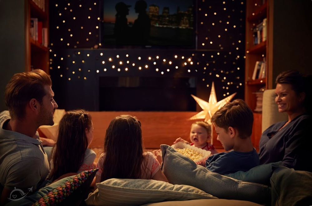 Family Enjoying Movie Night At Home Together | A Reinvented Mom #funchristmaspartyideas