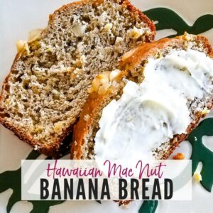 Two slices of Hawaiian Banana Bread, one with butter, on a plate | A Reinvented Mom