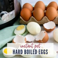 Close up view of hard boiled eggs on a counter top with carton of eggs, instant pot & a napkin | Instant Pot Hard Boiled Eggs | A Reinvented Mom