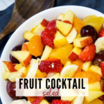 top view of fruit cocktail salad ready to serve with text overlay