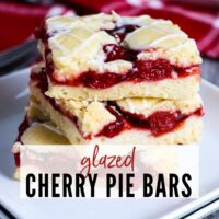 Three dessert bars on a white plate with Glazed Cherry Pie Bars graphic | A Reinvented Mom