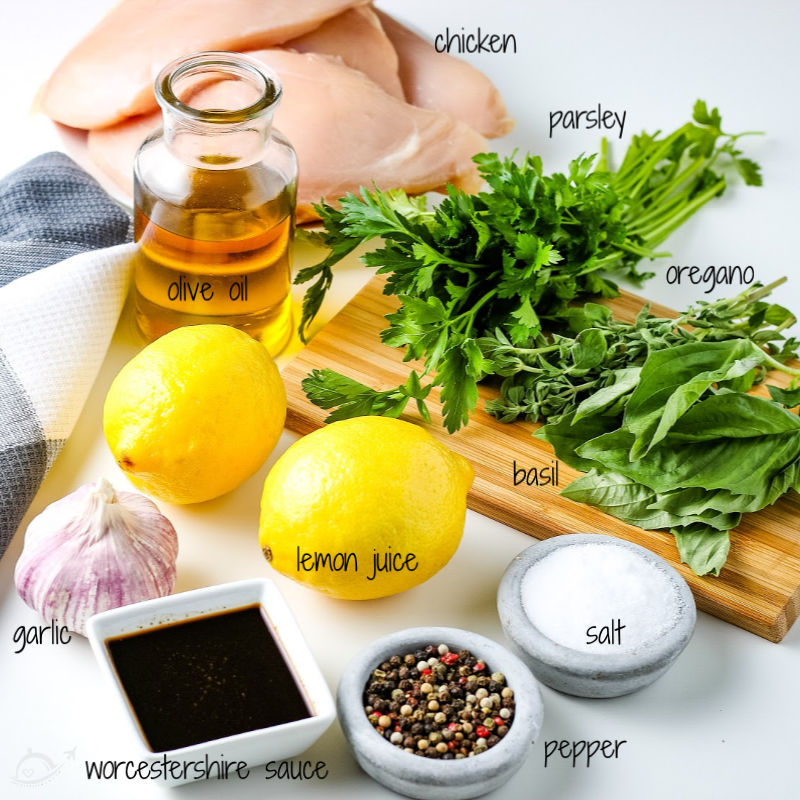 All of the ingredients needed for grilled italian chicken sitting on the kitchen countertop