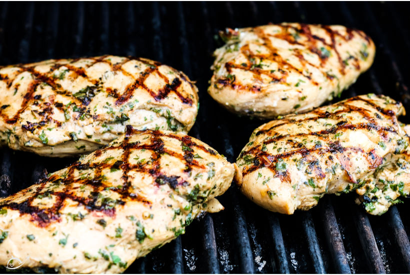 Italian grilled chicken resting on the grill before eating
