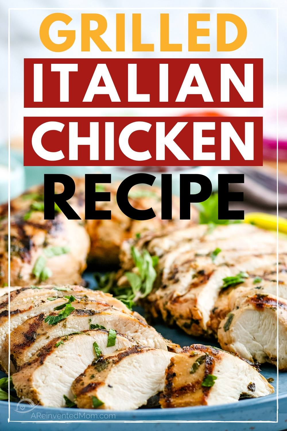 Close up of italian grilled chicken breasts topped with a garnish with a text overlay