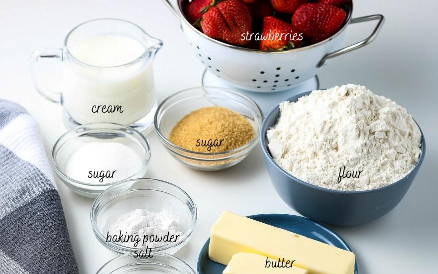 All ingredients set out ready to make strawberry shortcake with biscuits