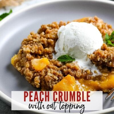 close up of peach crumble with oats topped with vanilla ice cream with text overlay