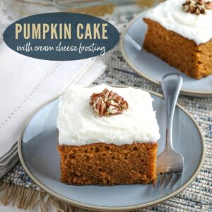 pumpkin cake with cream cheese frosting topped with pecans cut in a square on a blue plate with a fork next to another slice with text overlay