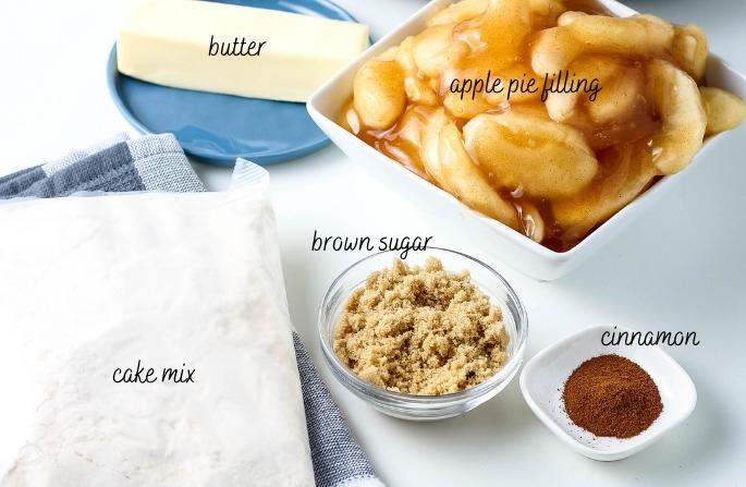 all ingredients for crockpot apple dump cake on a white counter