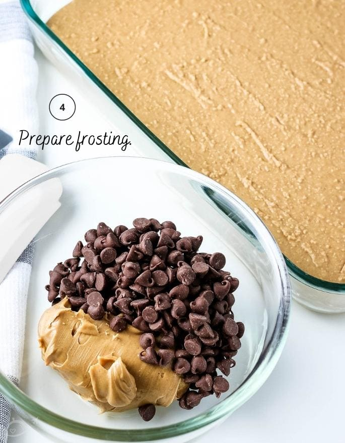peanut butter and chocolate chips in a glass bowl next to baking dish with graham cracker layer