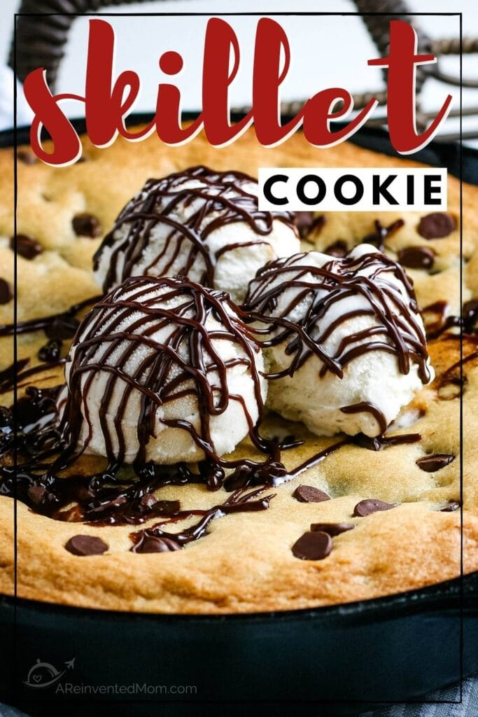 Chocolate chip cookie baked in a cast iron skilled topped with ice cream with text overlay