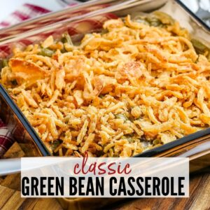 close up of green bean casserole topped with fried french onions in a glass dish with text overlay