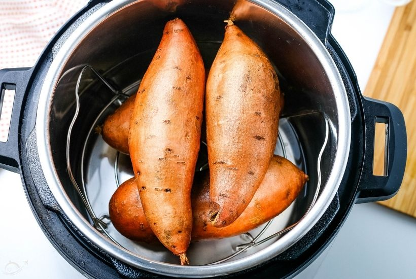 top view of sweet potatoes sitting inside of an Instant Pot