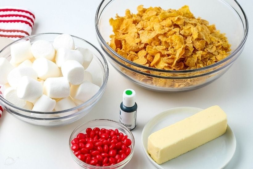 ingredients for cornflake wreaths in glass bowls on white counter