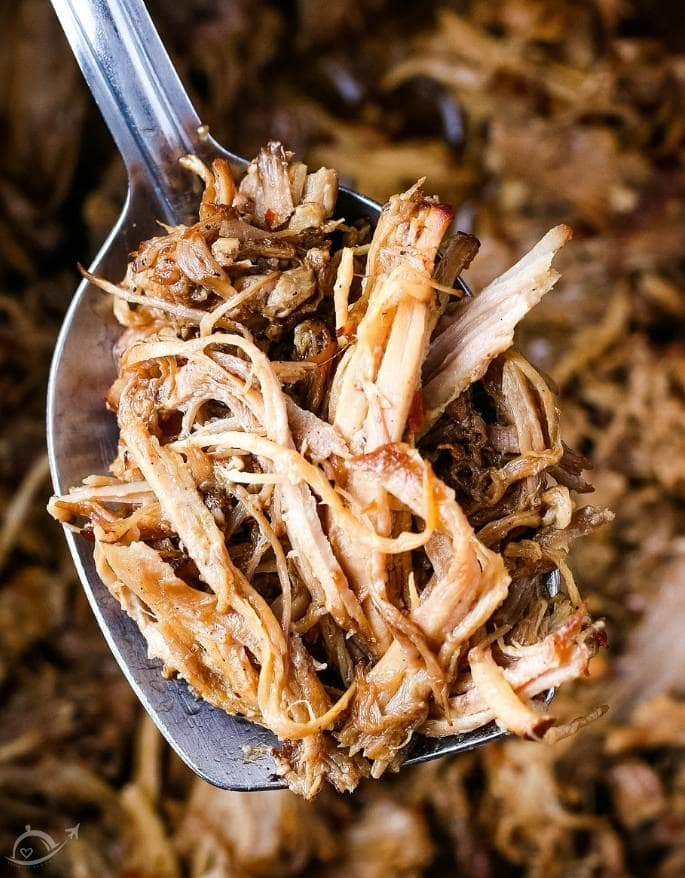 closeup of cooked pulled pork on a spoon