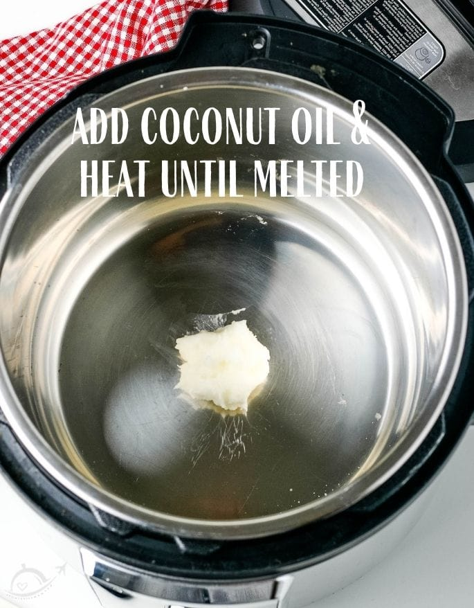 Coconut oil in instant pot text overlay add coconut oil and heat until melted