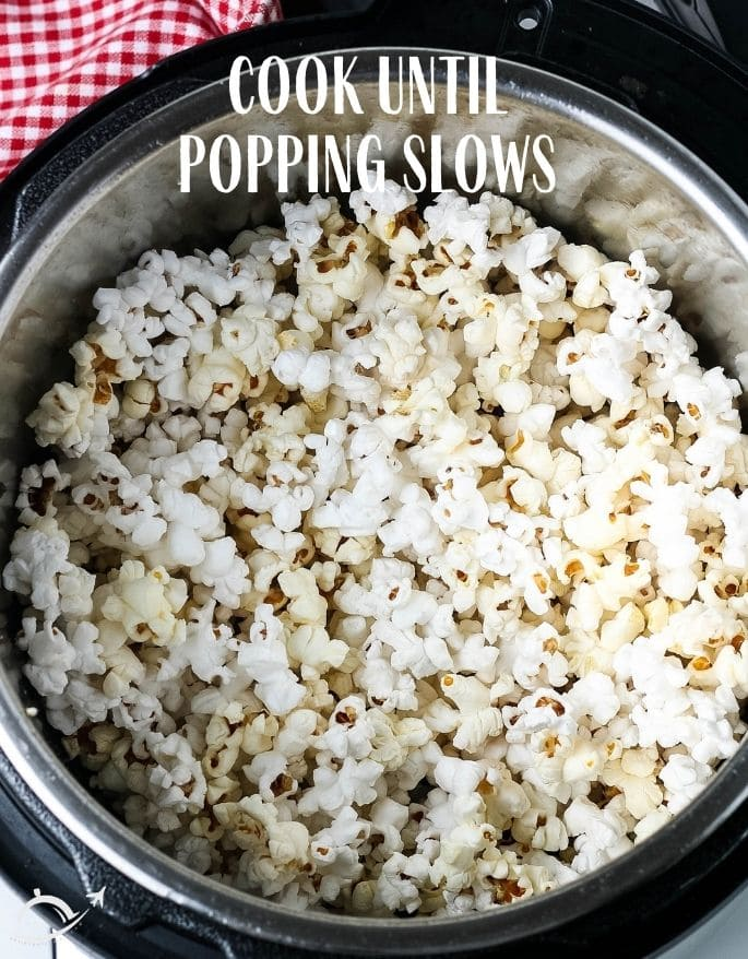 Popcorn in Instant Pot- with text overlay cook until popping slows