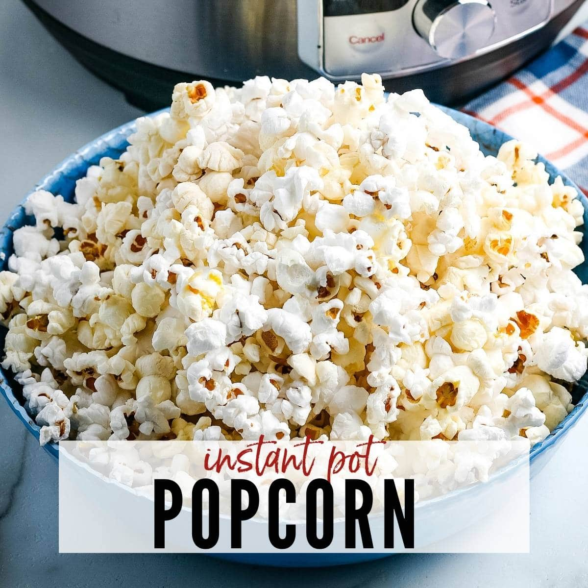 A bowl of popcorn with Insta Pot behind bowl. Text overlay Instant Pot Popcorn