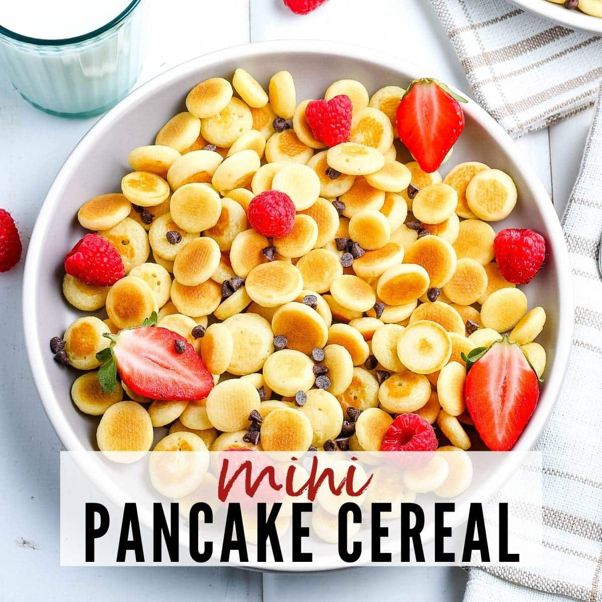 top view of mini pancake cereal in a white bowl with text overlay