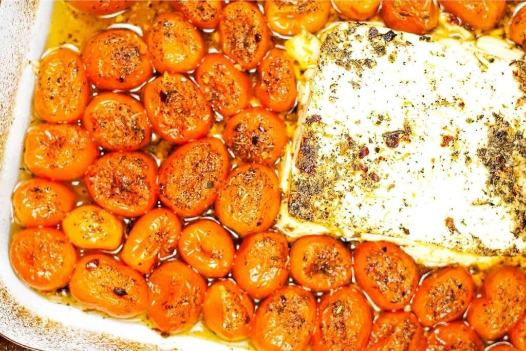 close up of feta tomato mixture in baking dish