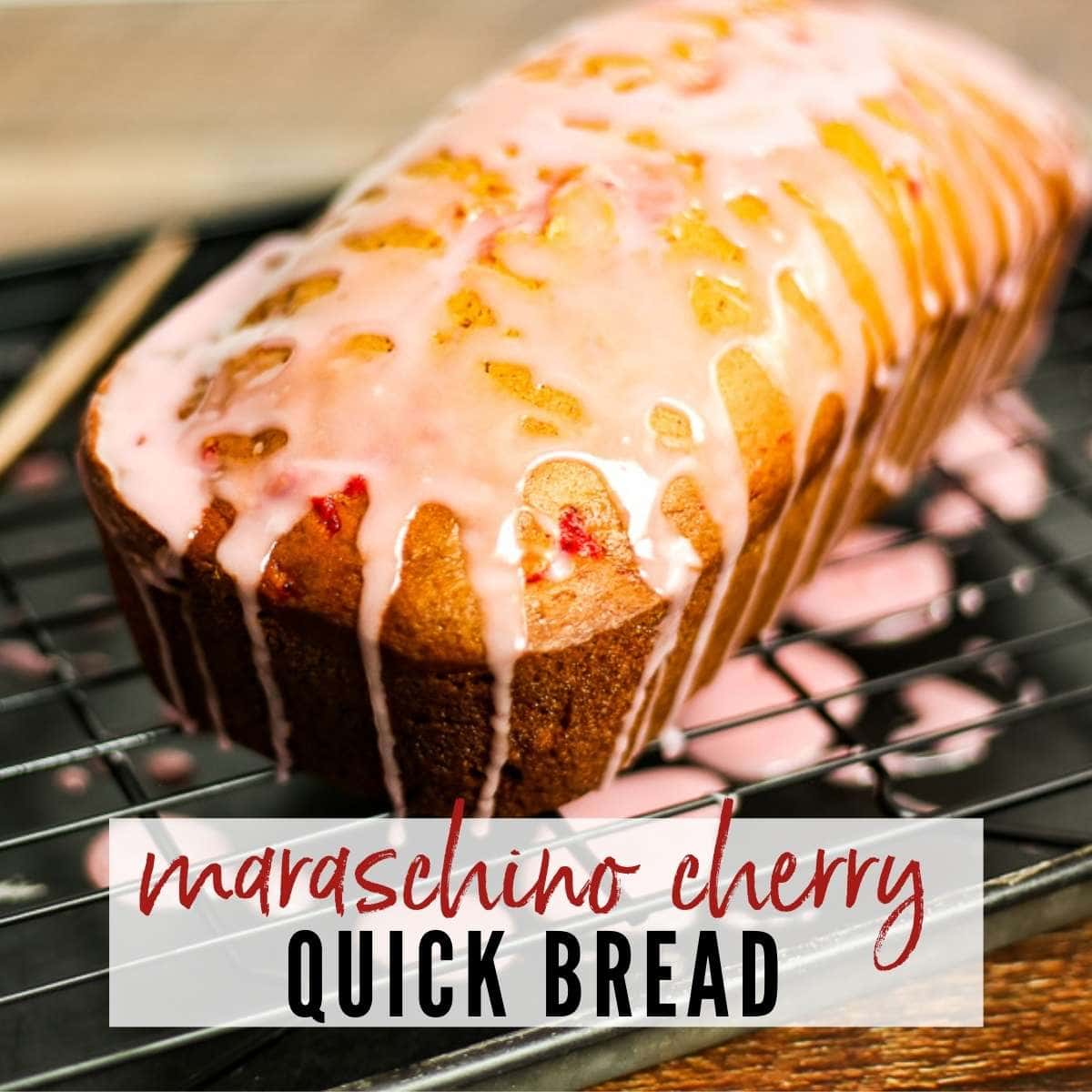 a loaf of cherry bread on a wire rack with a cherry glaze and text overlay