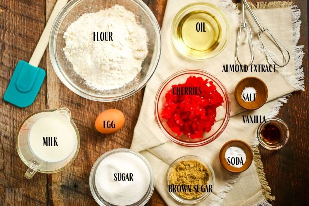 ingredients in different bowls for cherry quick bread and labeled with text