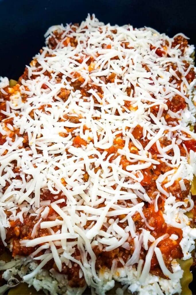 closeup view of uncooked lasagna in crockpot