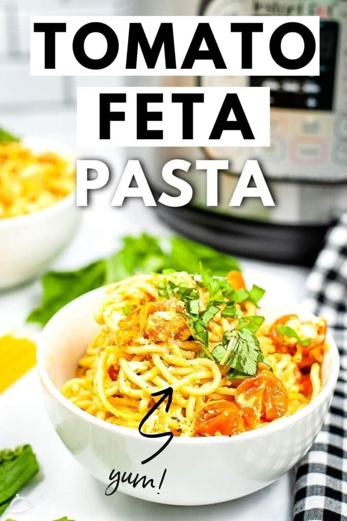bowl of spaghetti with tomatoes and feta cheese with black and white napkin and graphic overlay