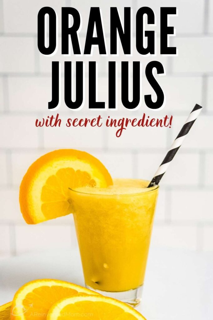 glass of orange Julius drink with orange slices on a white background with text overlay