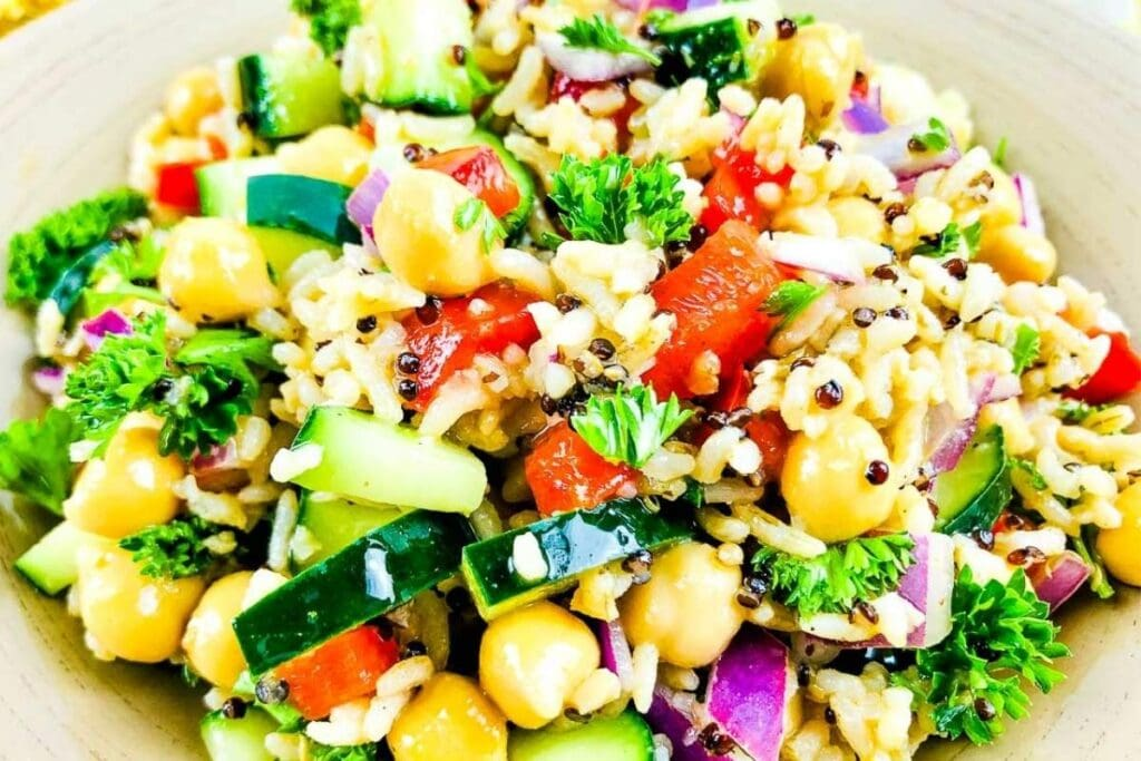 close up of quinoa chickpea salad in a small bowl