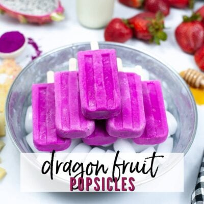 top shot of a batch of dragon fruit popsicles on ice in a galvanized tub with text overlay
