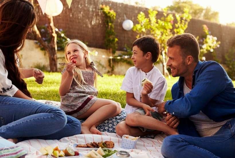 family enjoying a picnic in their backyard