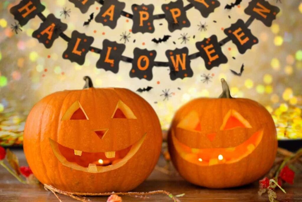 carved jack o lanterns with a halloween banner in the background