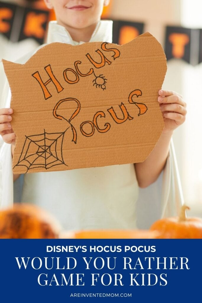 tween holding a hocus pocus sign with text overlay