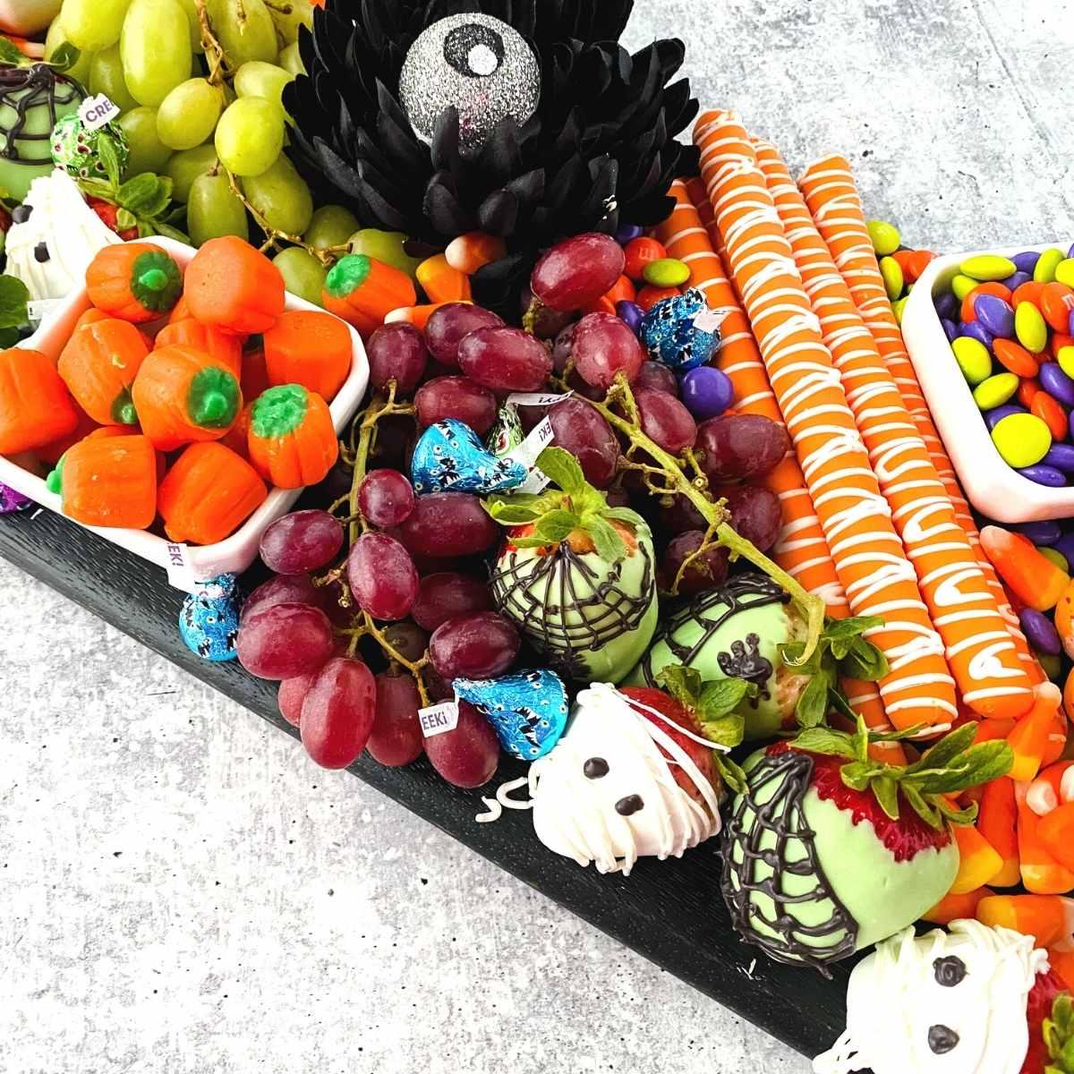 close up of a halloween charcuterie dessert board