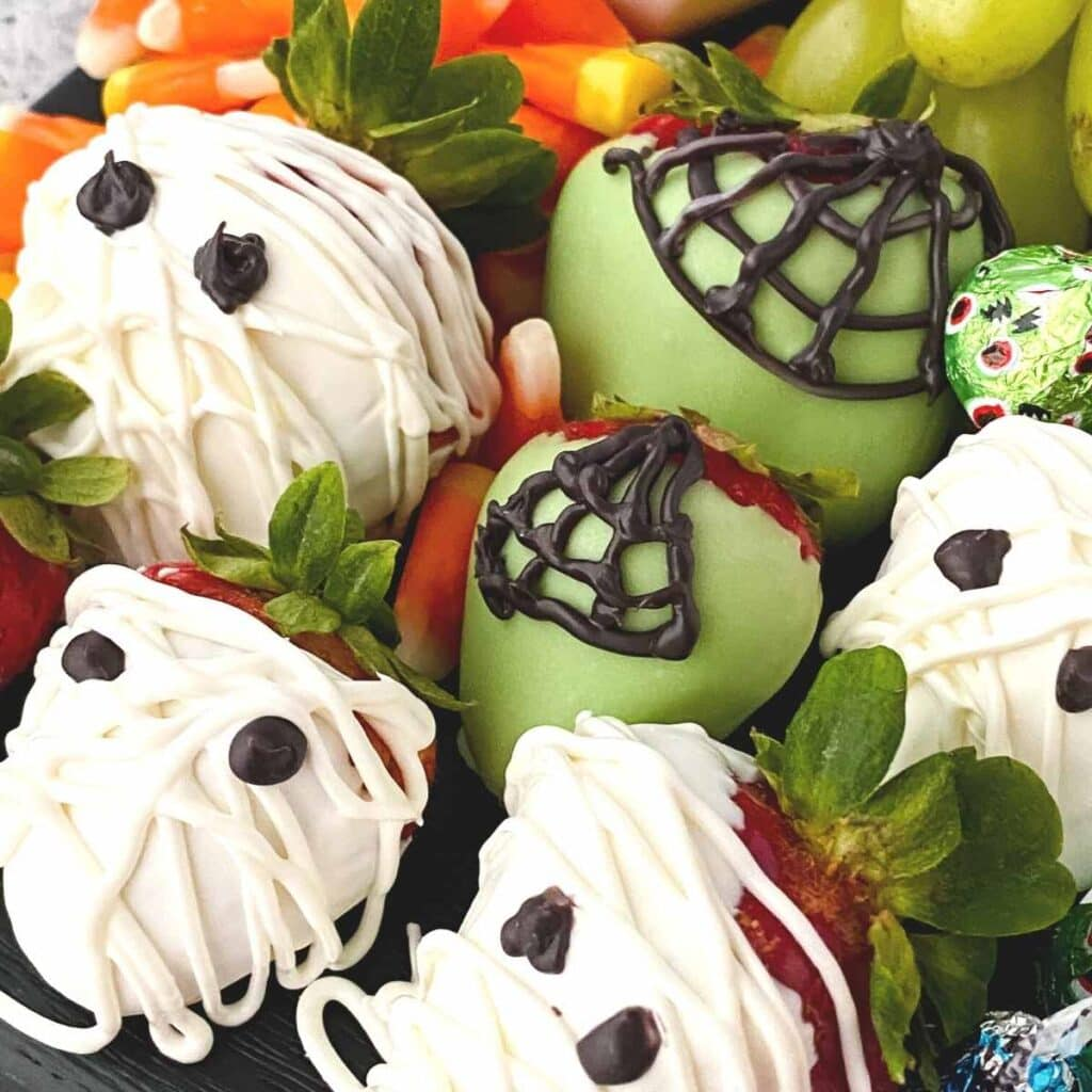 close up of mummies and spider chocolate covered strawberries for Halloween